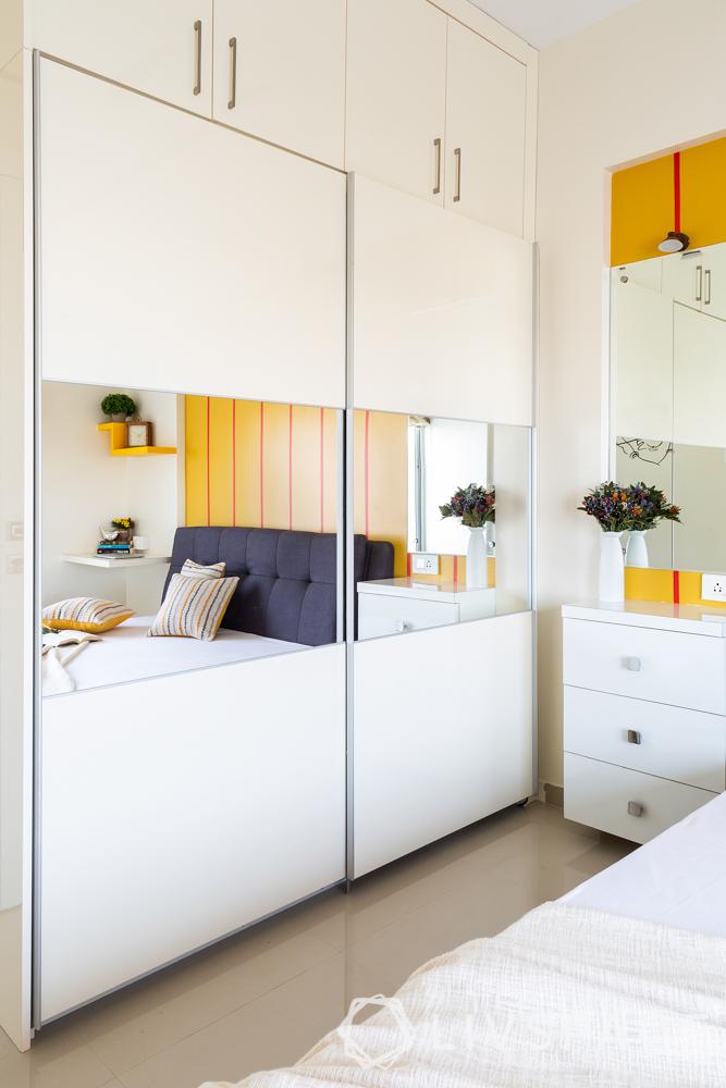 pune interior design-parents room-white sliding wardrobe-lofts-laminate