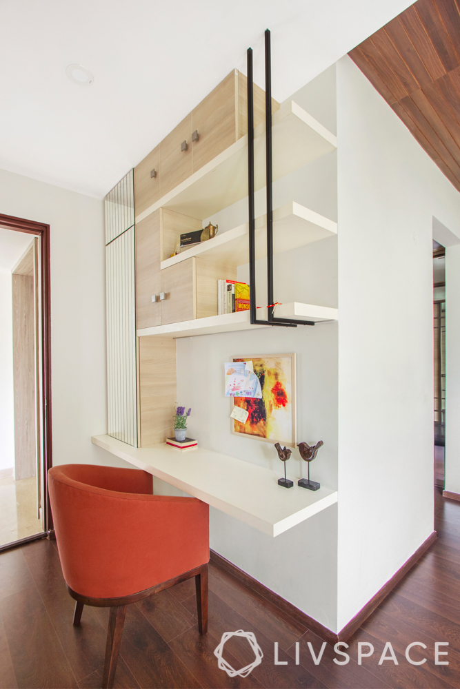 hdb bedroom design with study table-orange chair-beige shelves